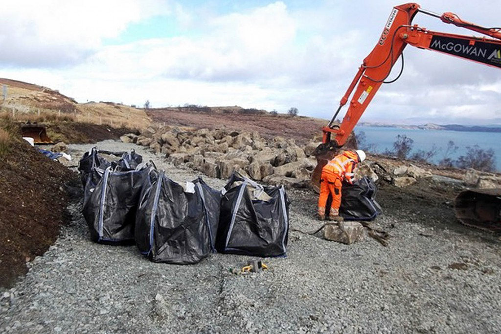 A worker bags stone at The Storr project. Photo: Outdoor Access Trust for Scotland