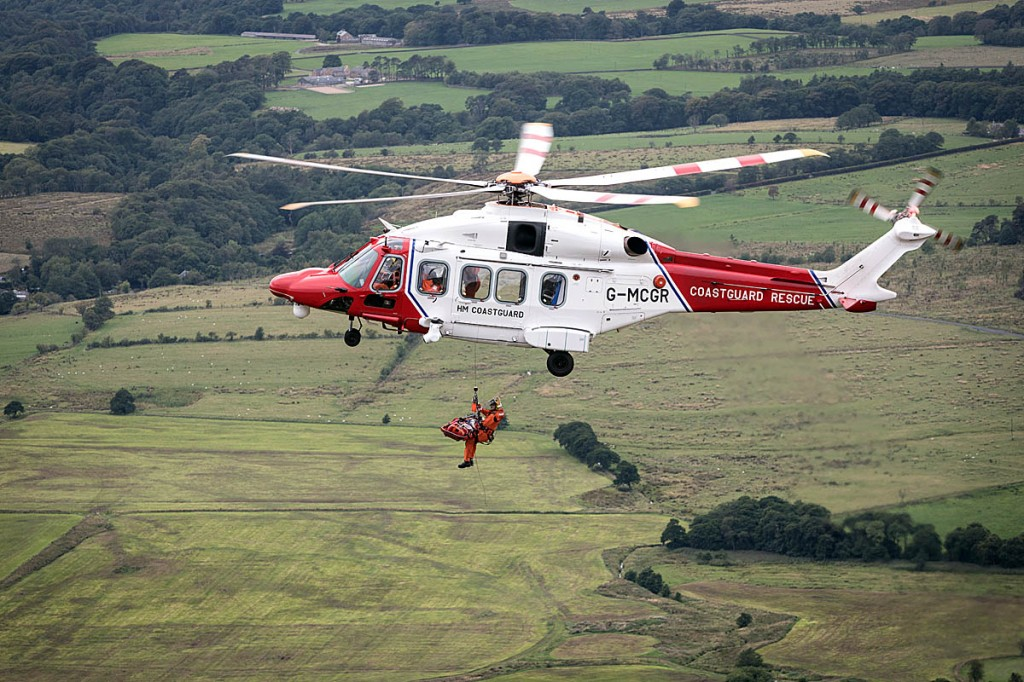 The injured paraglider is winched into the Coastguard helicopter. Photo: Bob Smith/grough