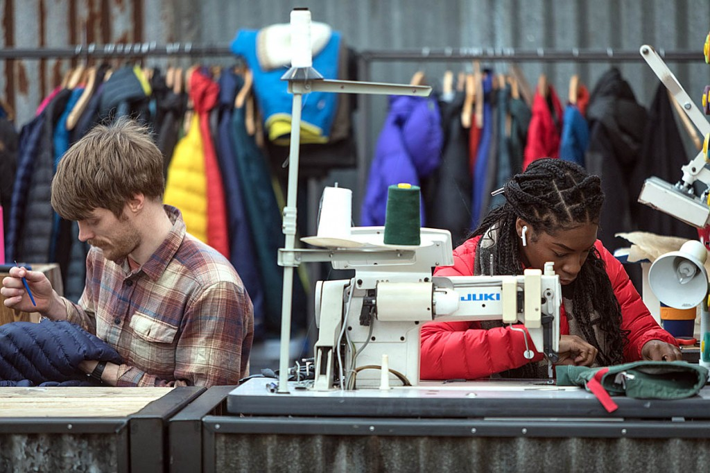 Patagonia Worn Wear workers repair clothing at last year's Kendal Mountain Festival. Photo: Bob Smith/grough