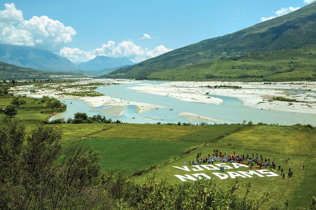 A flotilla protest on the banks of the Vjosa River in Albania, the largest of the last untamed rivers in Europe. Photo: Andrew Burr/Blue Heart