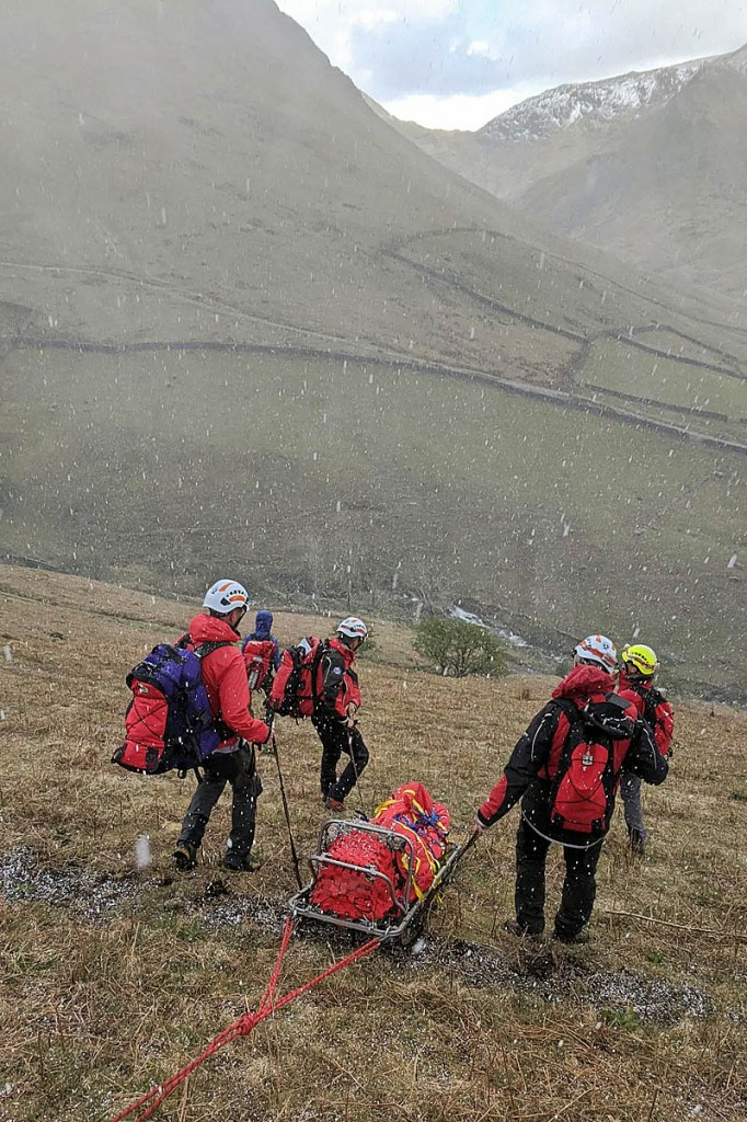 Rescuers used a rope system while sledging the stretcher down the fellside. Photo: Patterdale MRT