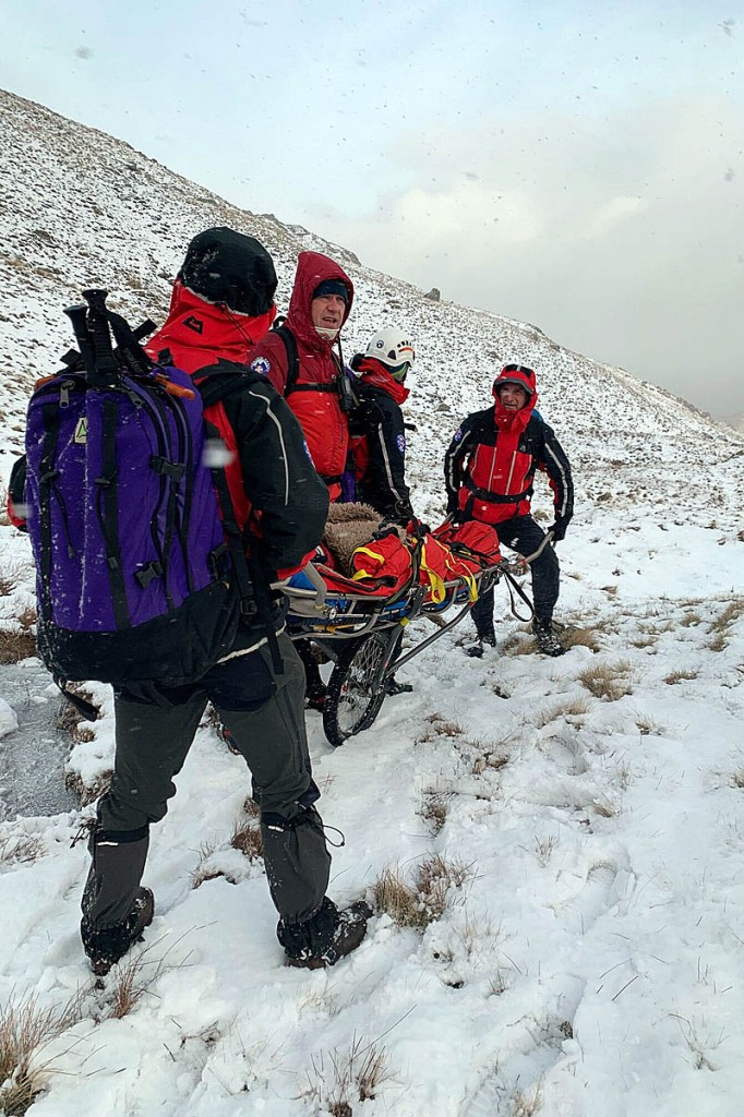 Rescuers stretcher the camper from Dove Crag. Photo: Patterdale MRT