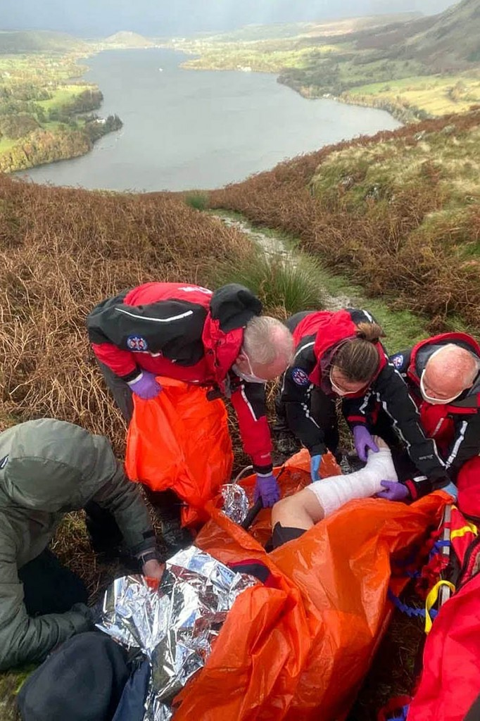 Team members treat the injured walker at the scene. Photo: Patterdale MRT