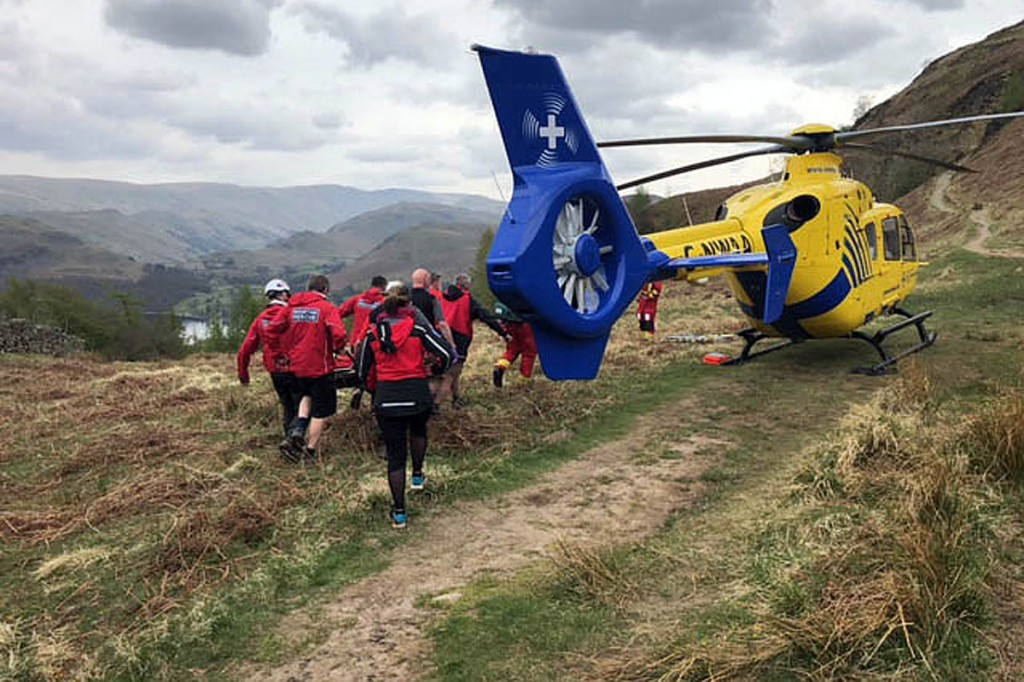 Rescue team members with the air ambulance at the scene. Photo: Patterdale MRT