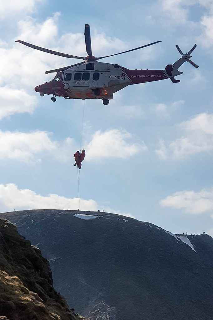 The injured walker is winched into the Coastguard helicopter. Photo: Patterdale MRT