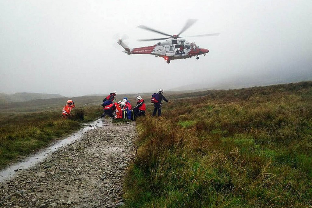 Rescuers with the Coastguard helicopter during one of the incidents. Photo: Patterdale MRT