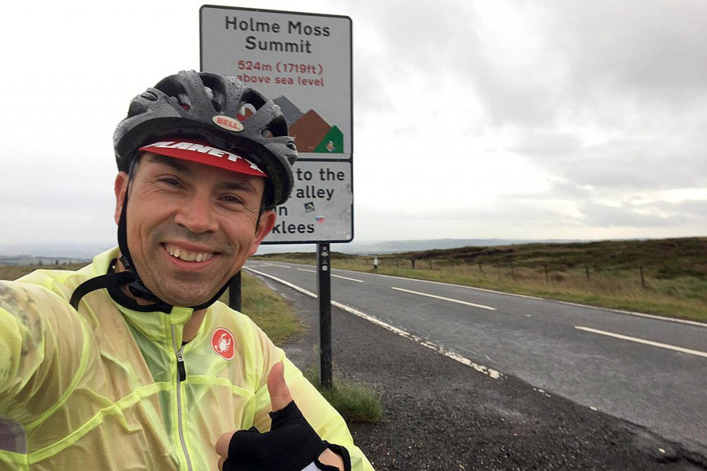 Alex Waddington at the top of the Holme Moss climb