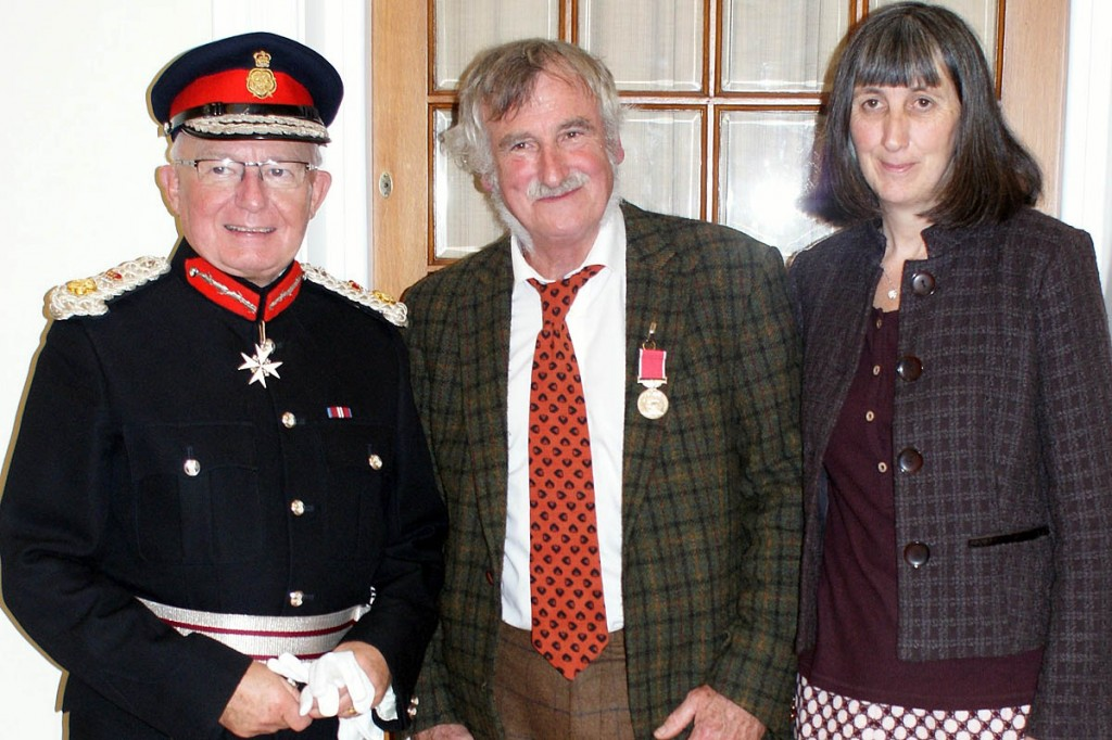 Bill Gordon sports his BEM, accompanied by his wife Flo and Lord Lieutenant William Tucker