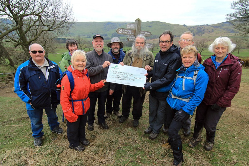 Members of the Ramblers group present a cheque to Mike Rhodes, fourth from right