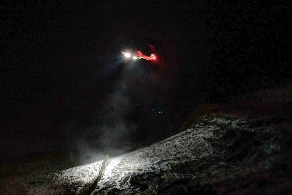 The Coastguard helicopter was finally able to winch the man from the fell. Photo: Penrith MRT