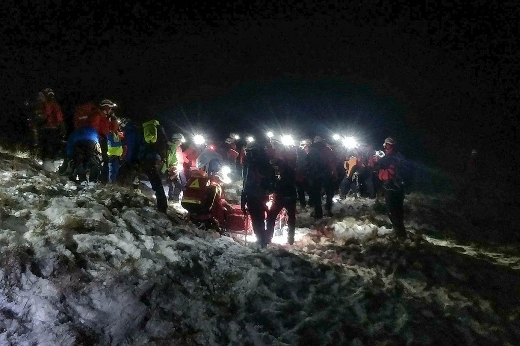 Rescuers lower the injured climber down the mountainside. Photo: Penrith MRT
