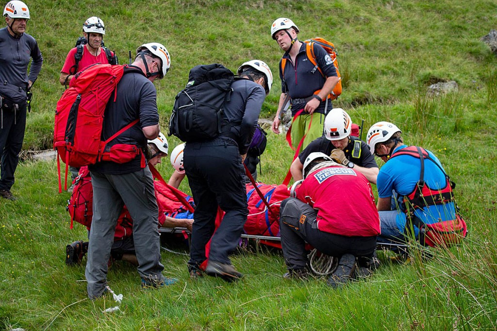 Rescuers with the injured walker at the scene above Mardale Head. Photo: Penrith MRT
