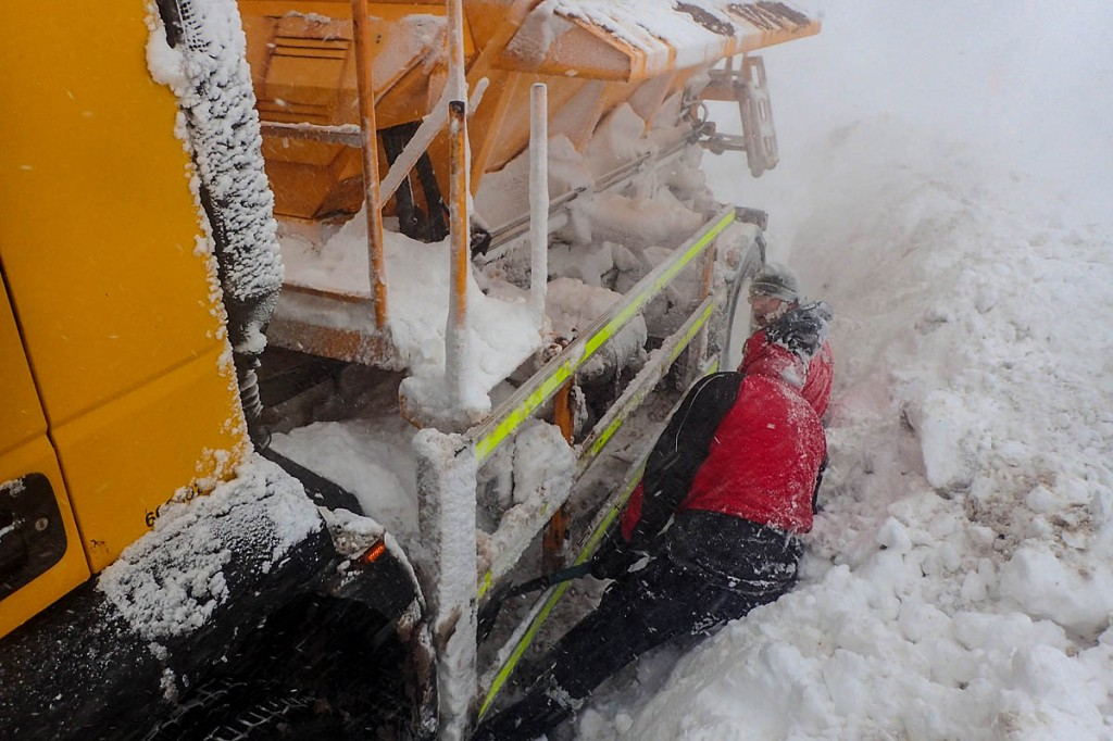 Mountain rescuers work to free the stranded snow plough. Photo: Matt Nightingale
