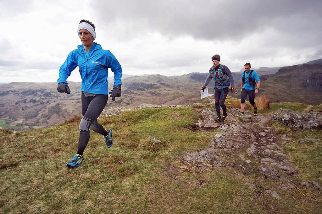 Sabrina Verjee descends Gibson Knott en route for Helm Crag, accompanied by pacers John Kelly and Ben Turner. Photo: Steve Ashworth