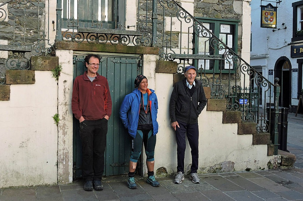 Sabrina Verjee is joined at the Moot Hall finish by Steve Birkinshaw, left, and Joss Naylor. Photo: Chris Lines