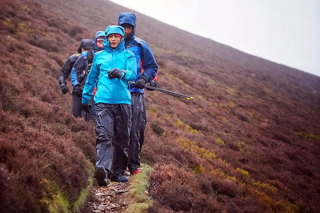 Sabrina Verjee heads to Ard Crags in heavy rain on Monday. Photo: Steve Ashworth