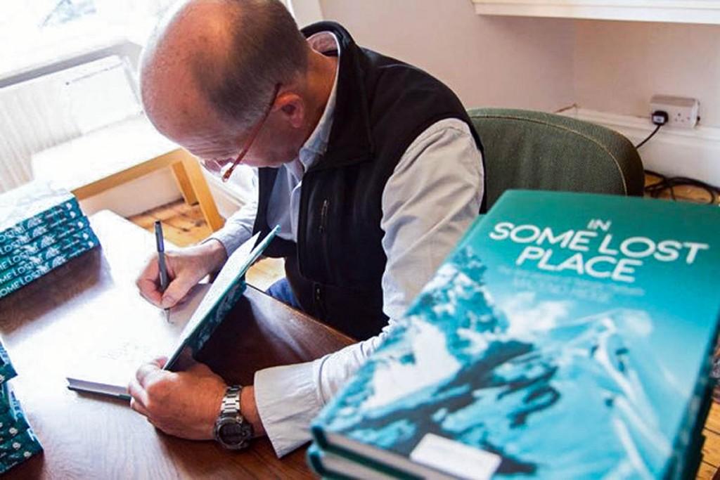 Sandy Allan signs copies of his work. Photo: John Coefield/Vertebrate Publishing