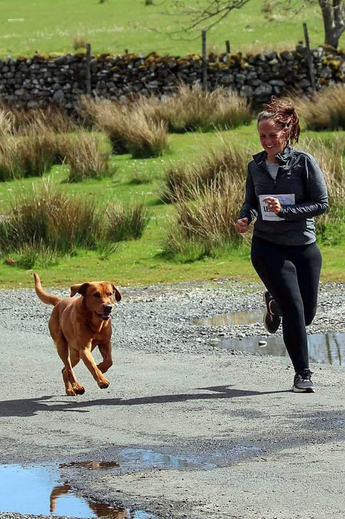 Leigh-Ann Newburn and Mac the dog take part in the relay