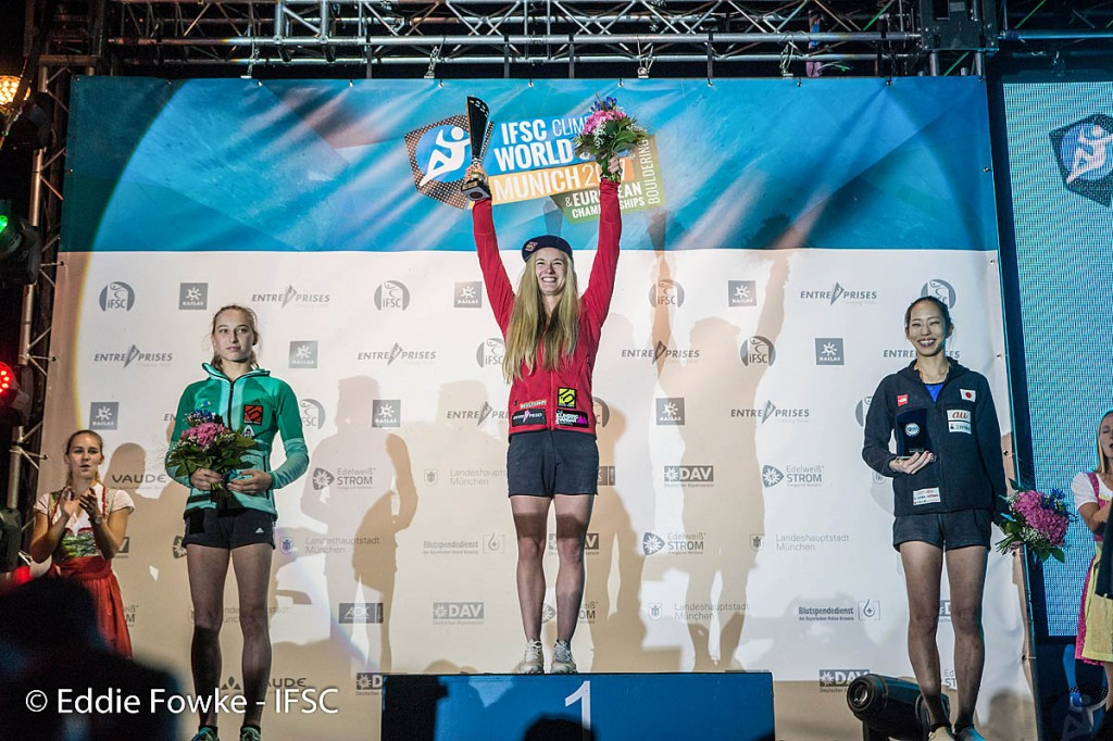 Coxsey, centre, celebrates her second bouldering world cup title. Photo: Eddie Fowke/IFSC