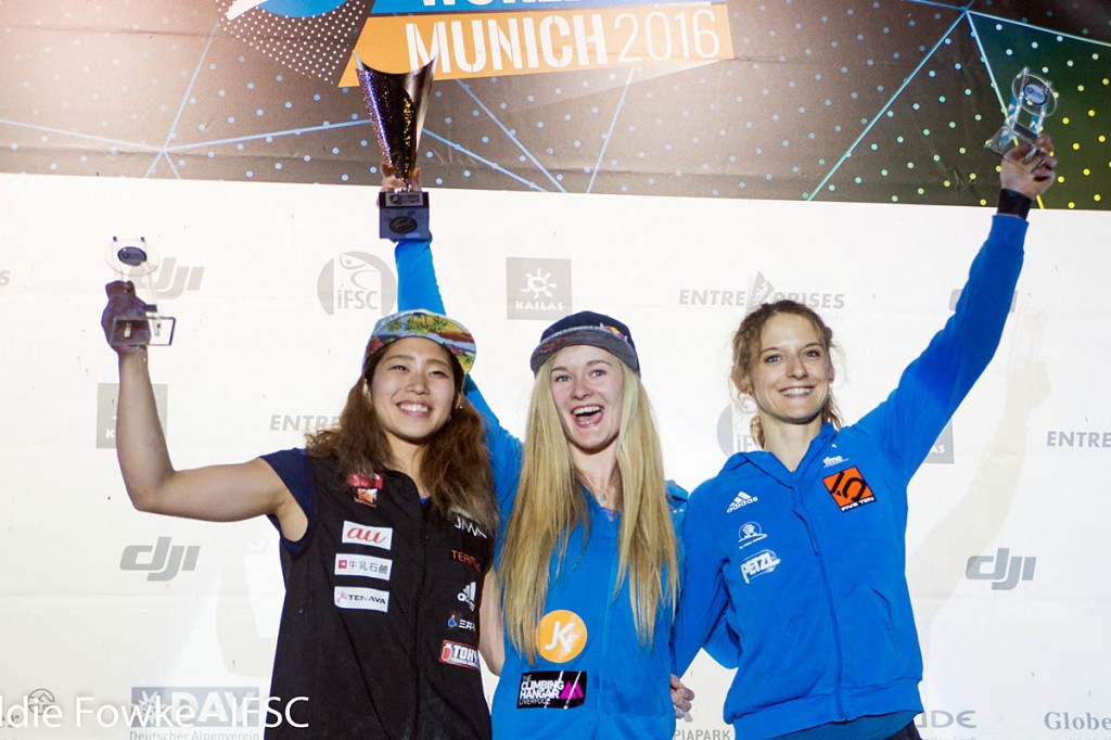 World bouldering champion Shauna Coxsey, centre, with second-place Miho Nonaka and Melissa Le Neve. Photo: Eddie Fowke/IFSC