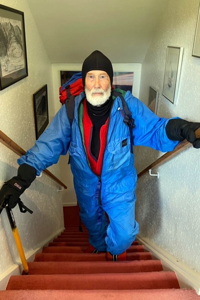 Sir Chris Bonington wears his original Everest outfit as he climbs his stairs