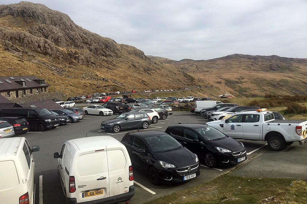 The Pen y Pass car park and surrounding roads were full of visitors's vehicles. Photo: Snowdonia NPA