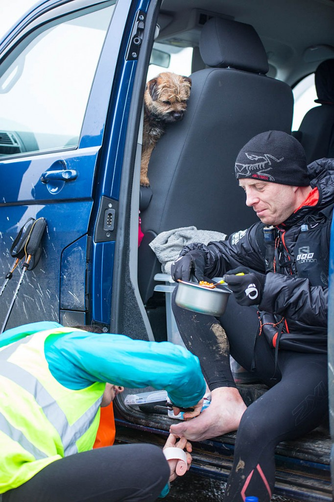 One runner receives attention during a stop. Photo: Yann Besrest-Butler/Montane Spine Race