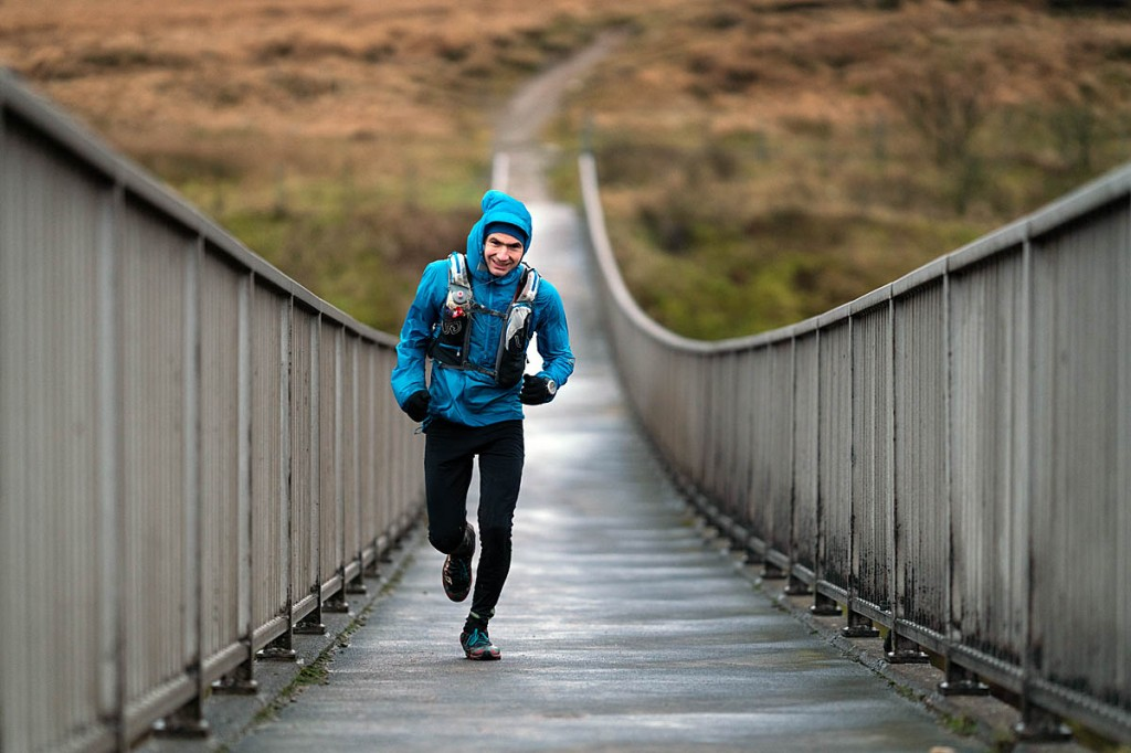 Jim Mann crosses the M62 on his way to victory in the Montane Spine Challenger. Photo: Harsharn Gill