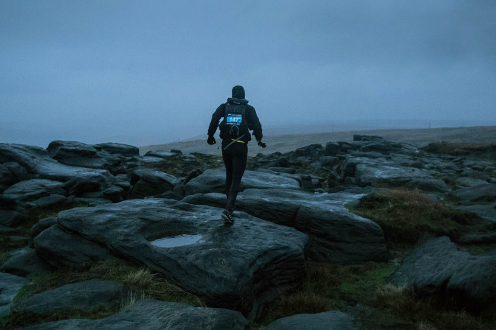 Shane Mooney negotiates Blackstone Edge as night falls in last year's Spine Challenger. Photo: Bob Smith/grough