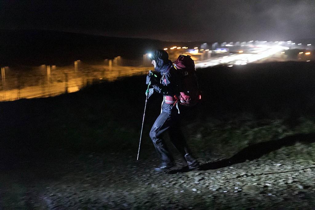 A runner prepares to cross the M62 bridge on Sunday night. Photo: Bob Smith/grough