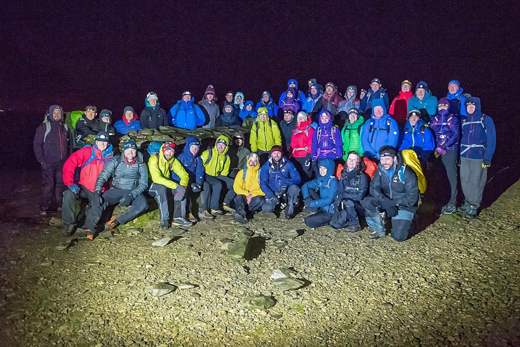 Walkers pose on the summit of the mountain. Photo: Nick Landells/Lakeland Photo Walks