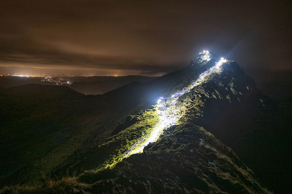 The trails of participants' headtorches on Striding Edge. Photo: Nick Landells/Lakeland Photo Walks