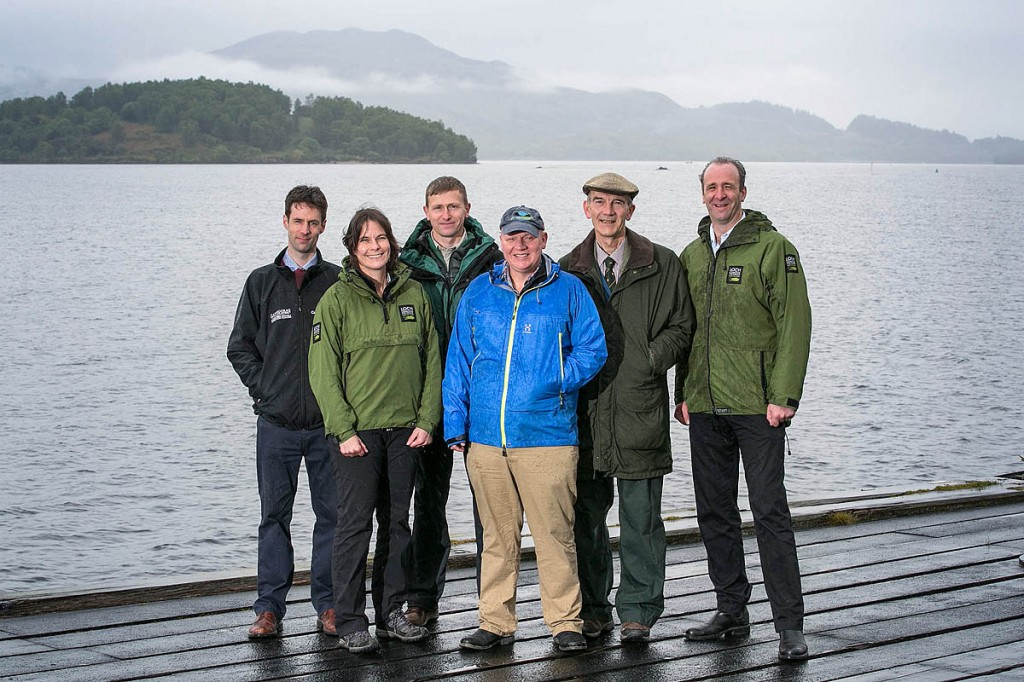 Celebrating the grant are: Hamish Trench, director of conservation and visitor experience at Cairngorms National Park Authority; Bridget Jones, head of visitor management at Loch Lomond & the Trossachs National Park Authority; Will Huckerby recreation manager at Forestry Commission Scotland; Dougie Baird, Cairngorms Outdoor Access Trust chief executive; trust chairman Peter Ord and Gordon Watson chief executive of Loch Lomond & the Trossachs National Park Authority. Photo: Michael McGurk