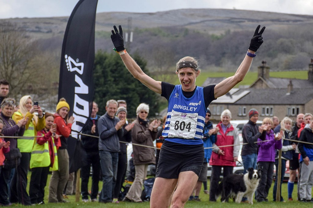 Victoria Wilkinson crosses the line at Horton to take the women's Three Peaks Race record