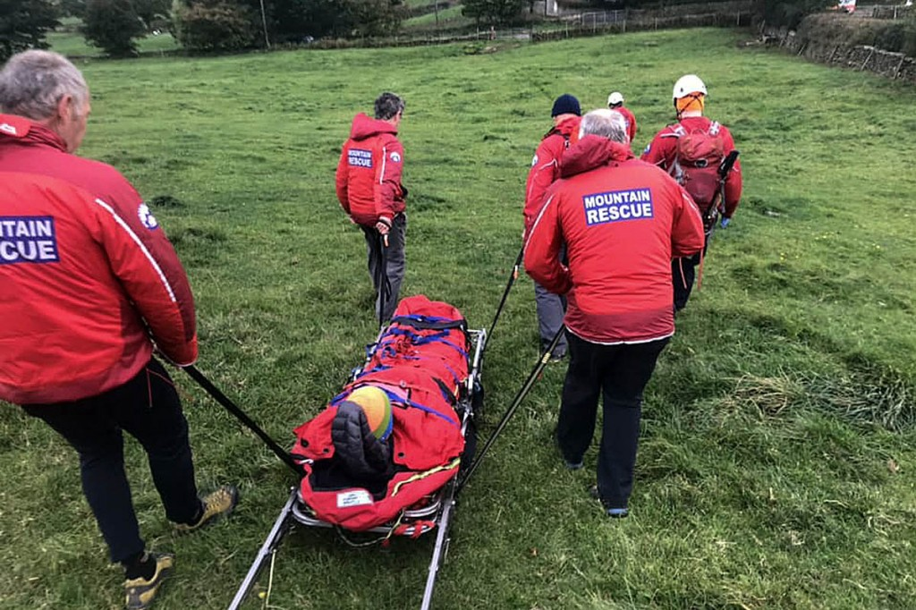 Rescuers stretcher the injured climber from the crag. Photo: UWFRA