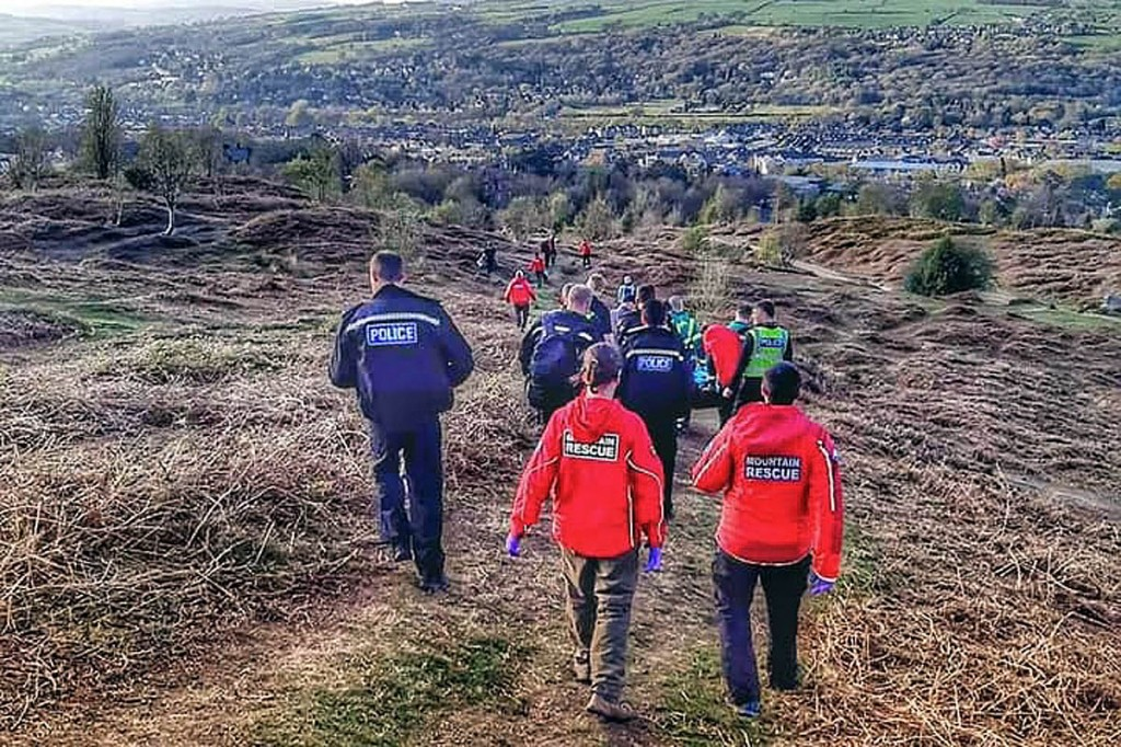 Rescuers help stretcher the injured cyclist from the moor. Photo: UWFRA