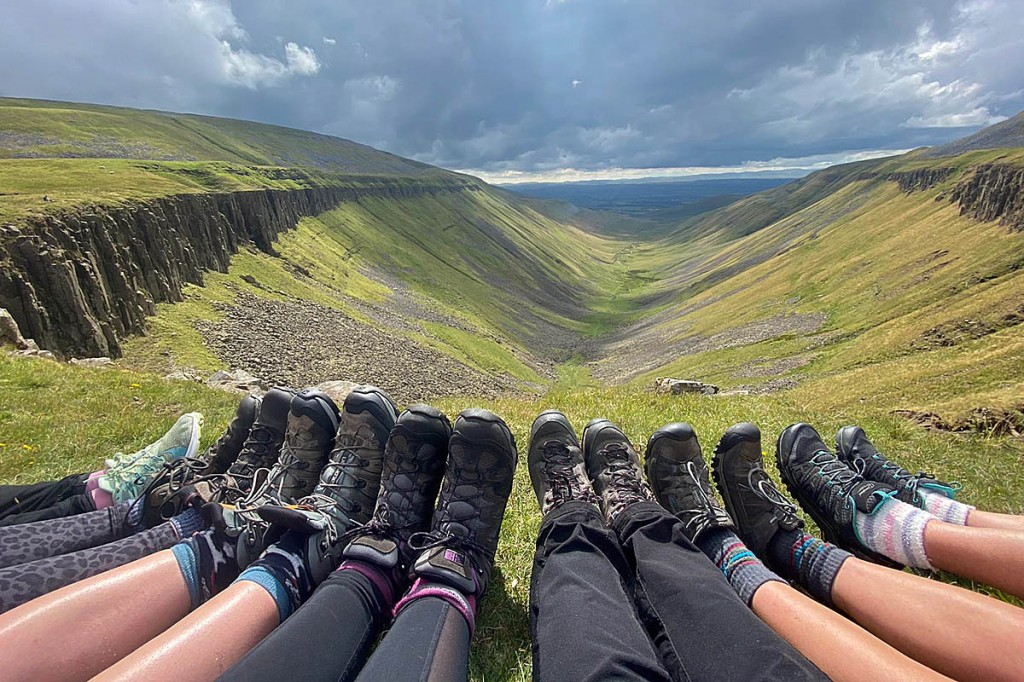 The Big Smile walkers enjoy a boot-level view of High Cup Nick in the North Pennines
