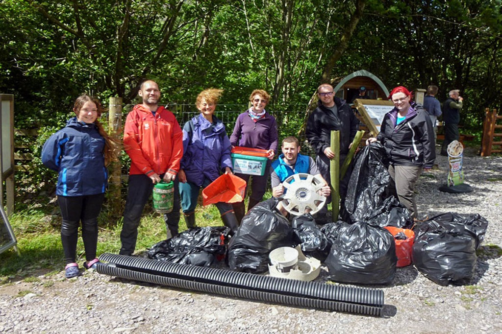 Volunteers with some of the rubbish collected from Wast Water by the canoe team
