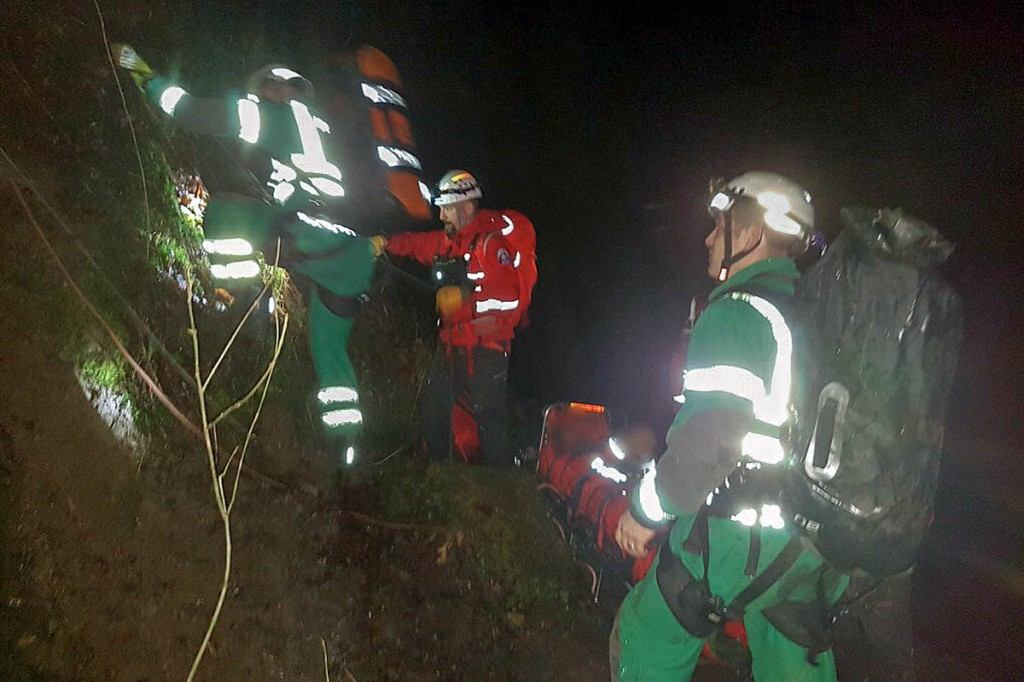 Rescuers at the site in the gorge at Henrhyd Falls. Photo: Western Beacons MSRT