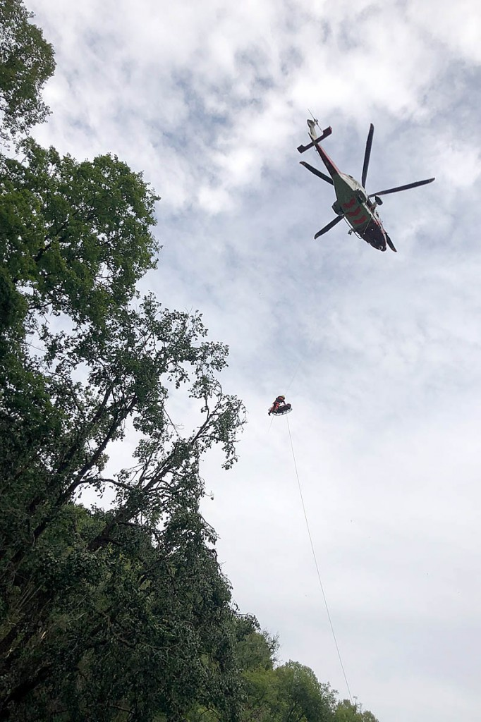 The injured teen is winched into the helicopter. Photo: Western Beacons MRT