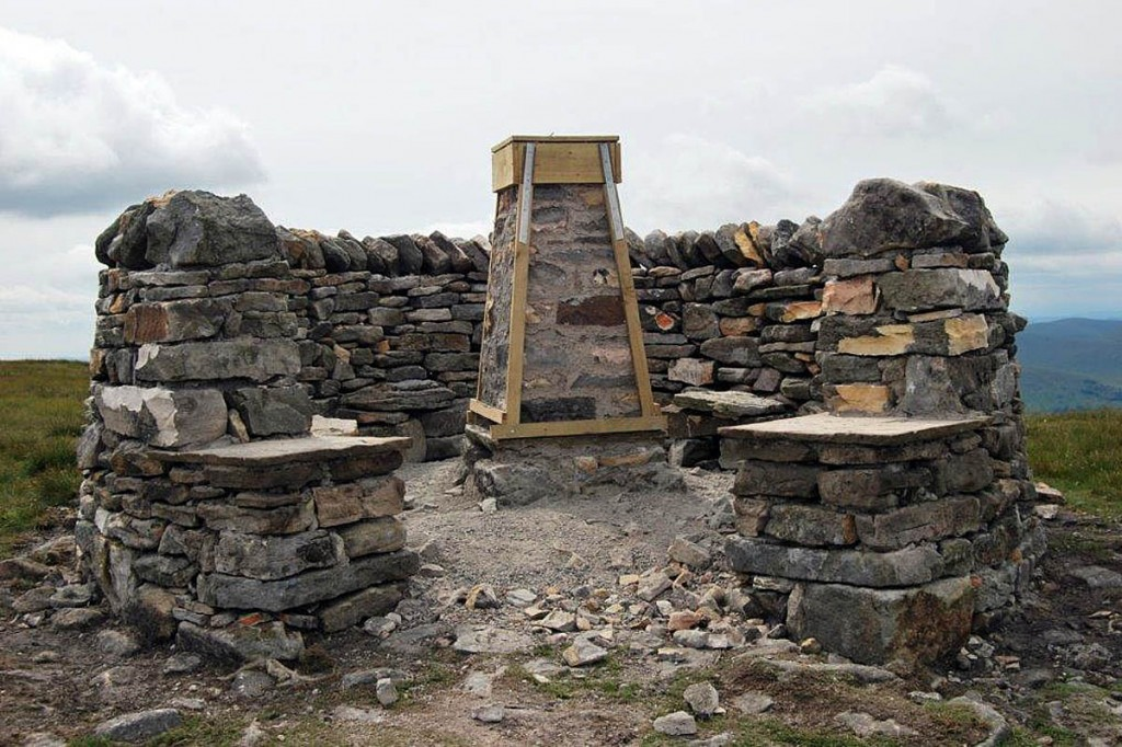 The restored trig pillar and shelter