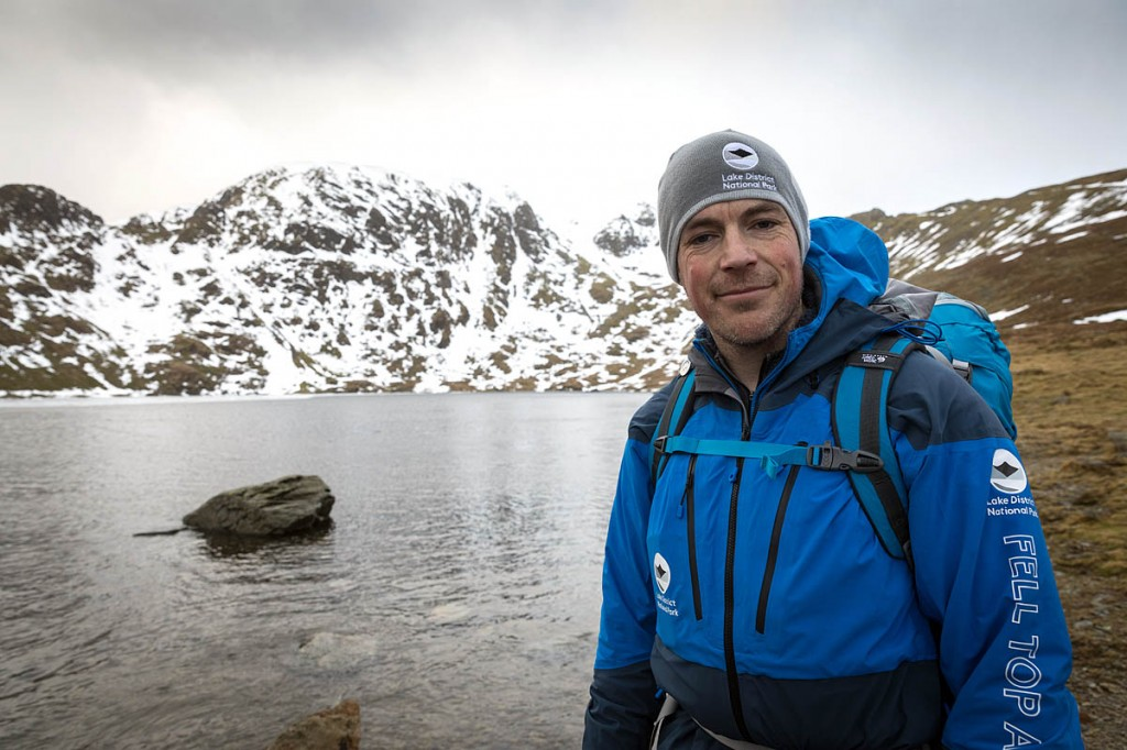 Zac Poulton at Red Tarn, with Helvellyn in the distance. Photo: Bob Smith/grough