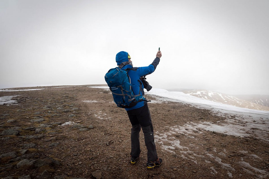 Zac Poulton takes a reading as winds approach 60mph on the summit plateau in a previous season. Photo: Bob Smith/grough