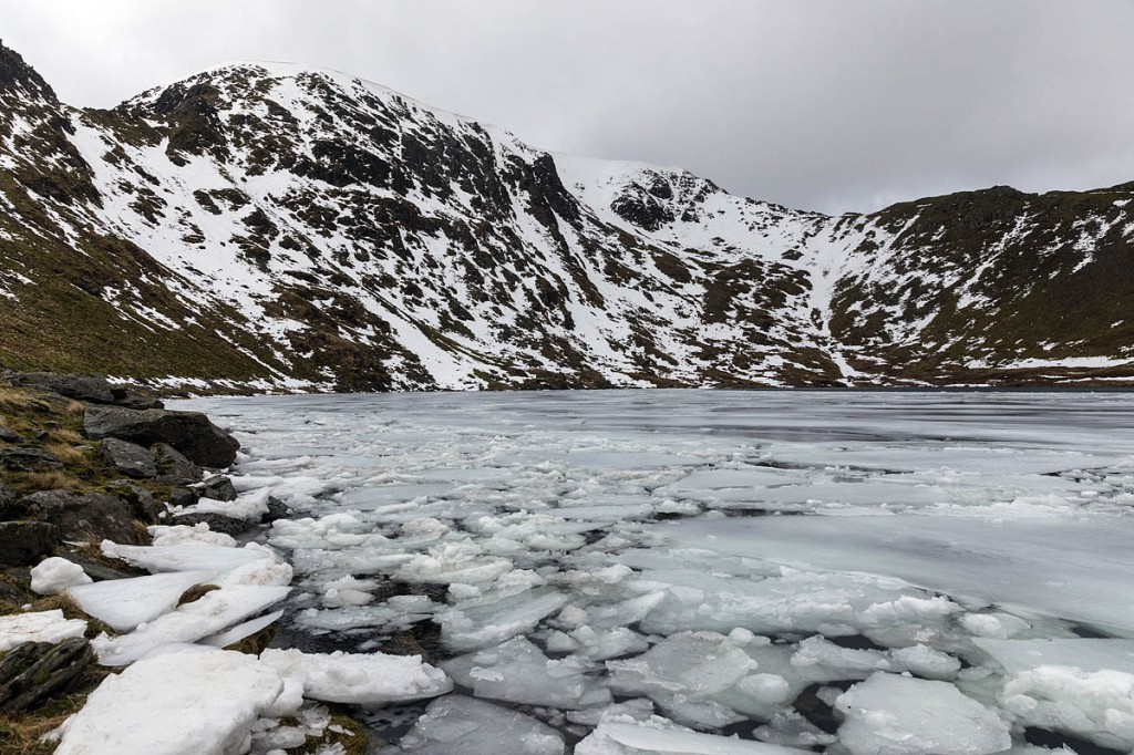 A partly frozen Red Tarn, with the Helvellyn headwall and Swirral Edge beyond. Photo: Bob Smith/grough