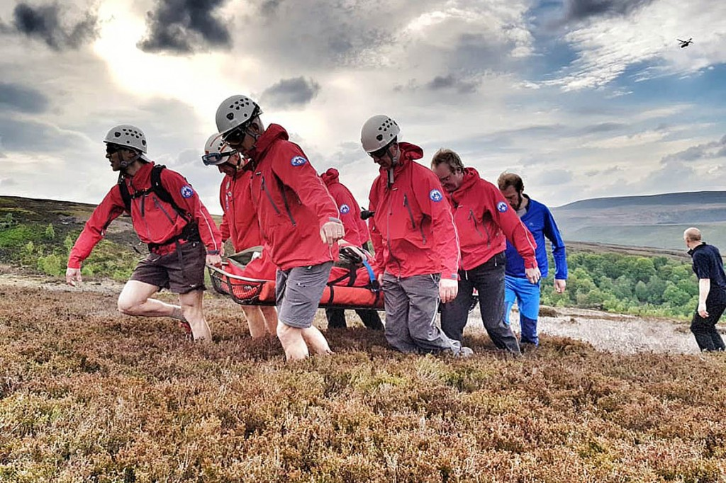Rescuers stretcher the casualty to the air ambulance. Photo: Woodhead MRT