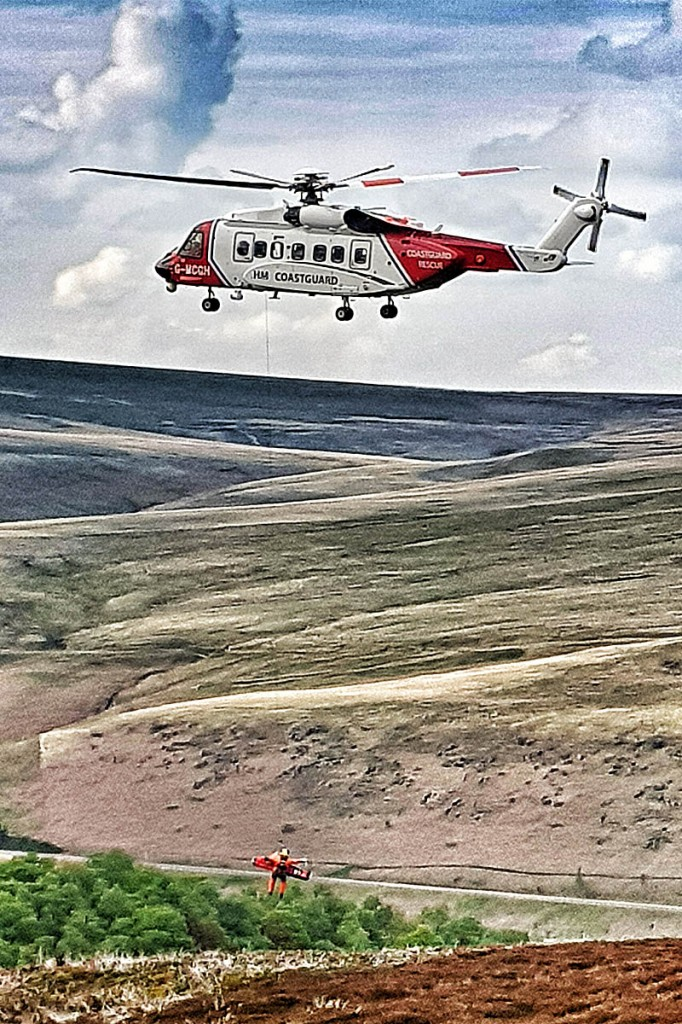 The woman is winched into the Coastguard helicopter. Photo: Woodhead MRT