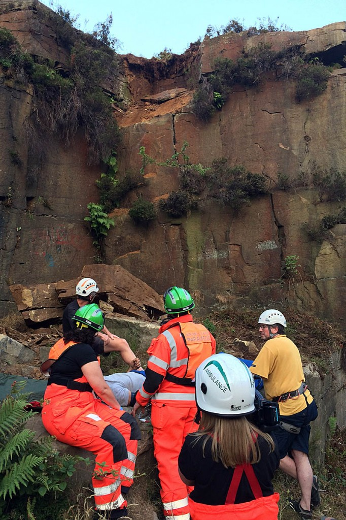 Rescuers at the scene with the climber where a large section of the quarry crashed to the ground. Photo: Woodhead MRT