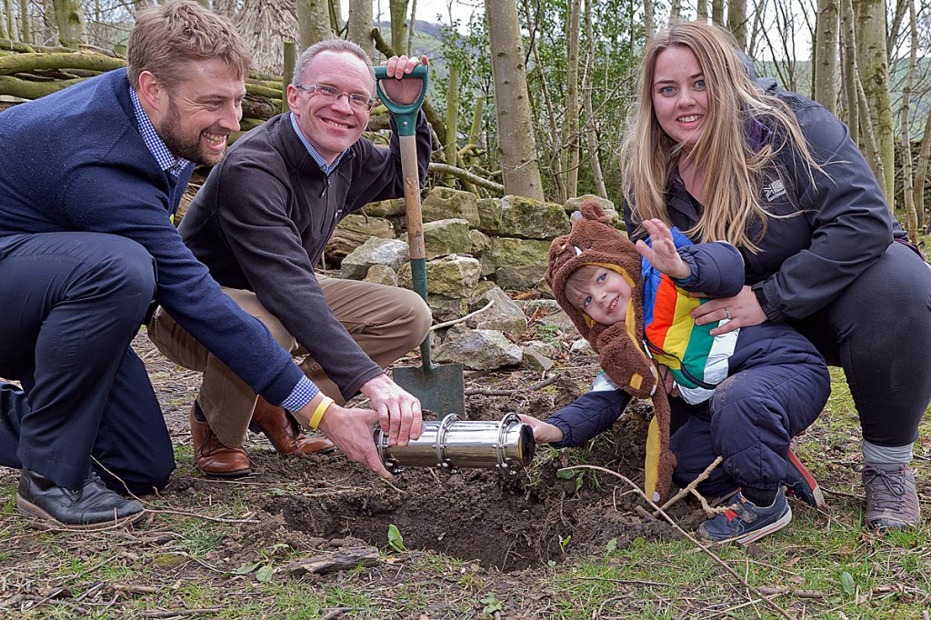 Burying the time capsule are, from left Ian Priddle, manager of YHA Castleton; James Blake, chief executive of YHA (England and Wales), with YHA guests Jackson Holt, three, and Stephanie Hall