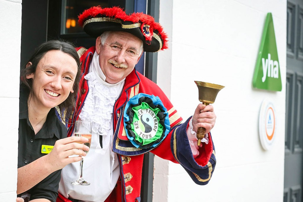 Hostel manager Rachel Kirkby is joined by the Keswick town crier at the opening. Photo: Ceri Oakes