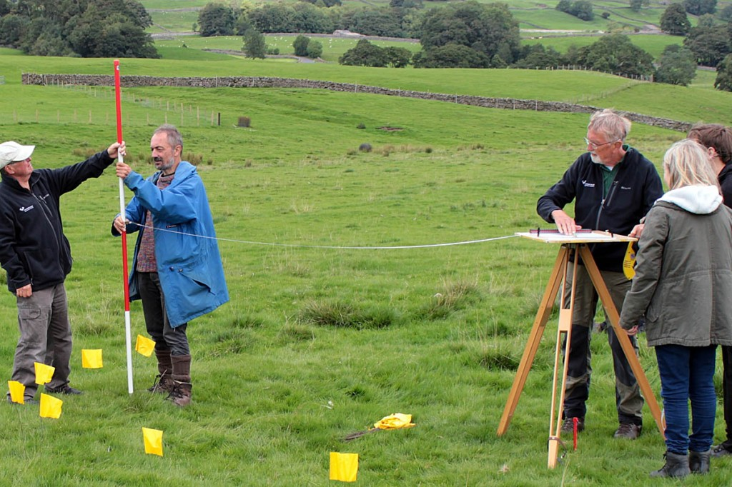People learn how to use the 'plane table method' to survey a stack stand near Floshes Hill. Photo: YDNPA